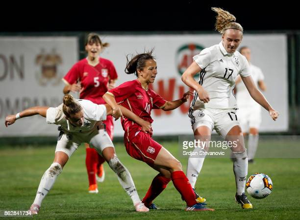 Sandra Malesevic of Serbia is challenged by Annalena Rieke and Giulia Gwinn of Germany during the international friendly match between U19 Women's...
