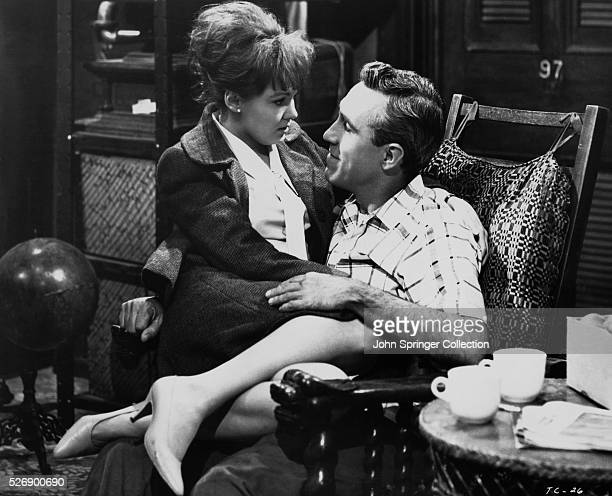 Sandra Markowitz sits on Murray Burns' lap in a scene from A Thousand Clowns