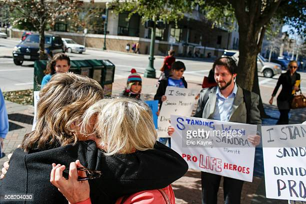 Sandra Merritt, a defendant in a recent indictment reversal stemming from a Planned Parenthood surreptitious video she helped produce, hugs a...