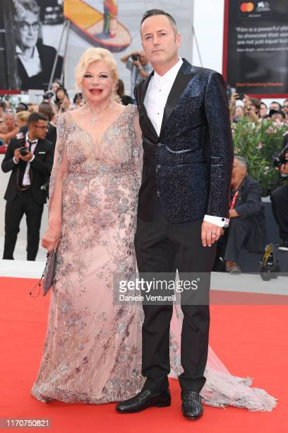 Sandra Milo and Alessandro Rorato walk the red carpet ahead of the Opening Ceremony and the La Vérité screening during the 76th Venice Film Festival...