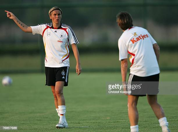 Sandra Minnert issues instructions to Ariane Hingst during the Women's German National Team training session on the training ground at the Wuhan...