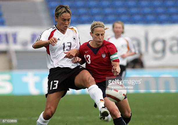 Sandra Minnert of Germany and Christine Lilly challenge for the ball during the Womens Algarve Cup match between Germany and USA on March 15, 2006 in...