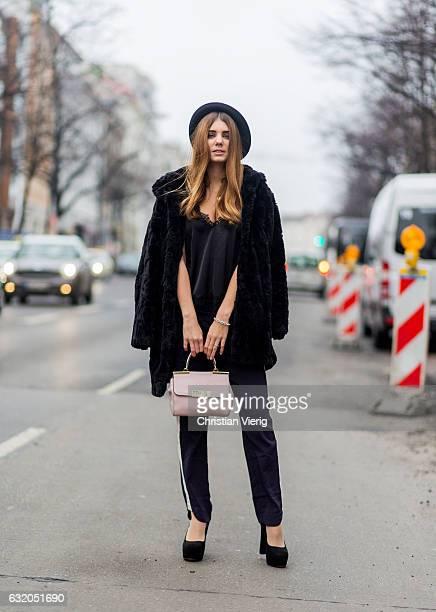 Sandra Niederreiner wearing a black fake fur jacket hat silk top jogger pants heels during the MercedesBenz Fashion Week Berlin A/W 2017 at Kaufhaus...