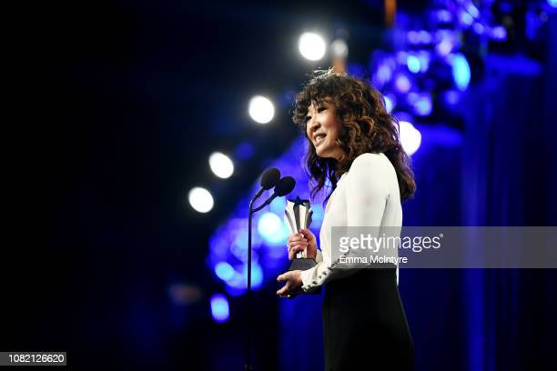 Sandra Oh accepts Best Actress in a Drama Series for 'Killing Eve' onstage at the 24th annual Critics' Choice Awards at Barker Hangar on January 13...