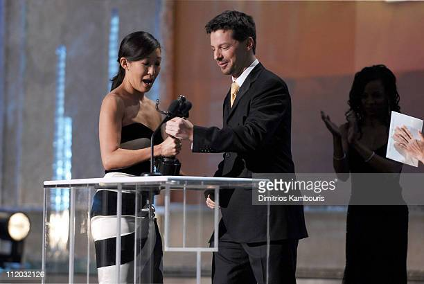 Sandra Oh accepts the award for Outstanding Performance by a Female Actor in a Drama Series from Sean Hayes 10612_dk0283jpg