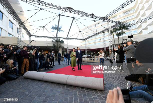 Sandra Oh and Andy Samberg hosts of the 76th Annual Golden Globe Awards pose after rolling out the red carpet during a preview day at The Beverly...