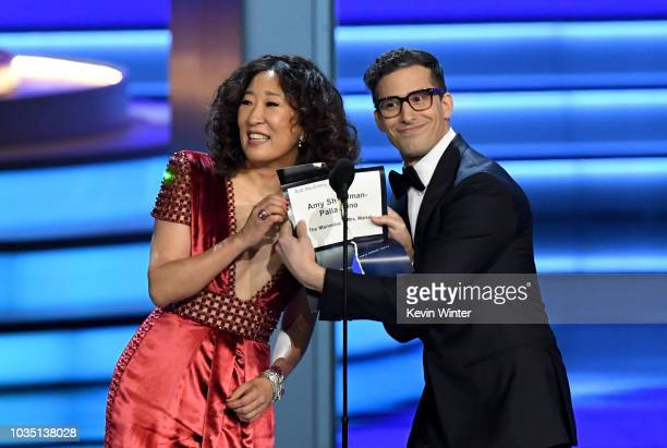 Sandra Oh and Andy Samberg present the Outstanding Directing for a Comedy Series award onstage during the 70th Emmy Awards at Microsoft Theater on...