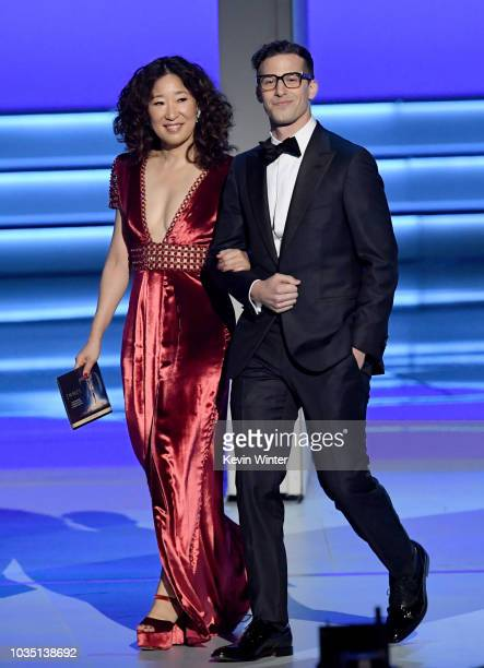 Sandra Oh and Andy Samberg walk onstage during the 70th Emmy Awards at Microsoft Theater on September 17 2018 in Los Angeles California