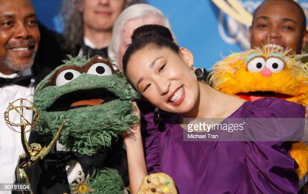 Sandra Oh and the cast of Sesame Street, winners of the Emmy for Lifetime Achievement Award, pose in the press room at the 36th Annual Daytime Emmy...
