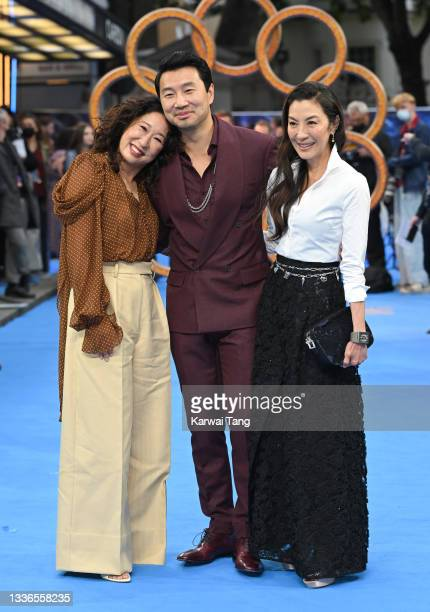 """Sandra Oh, Simu Liu and Michelle Yeoh attend the UK premiere of """"Shang-Chi and the Legend of the Ten Rings"""" at The Curzon Mayfair on August 26, 2021..."""
