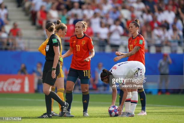 Sandra Paños and Alexia Putellas of Spain talk as Alex Morgan of the United States spots the ball during a 2019 FIFA Women's World Cup France Round...