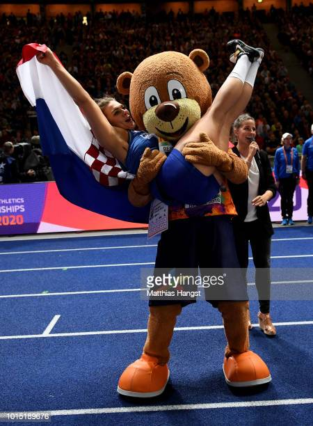 Sandra Perkovic of Croatia celebrates with the European Athletics Championships mascot Berlino after winning Gold in the Women's Discus Throw Final...