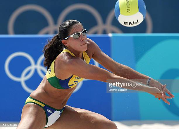 Sandra Pires of Brazil clines the ball up for a hit in the women's preliminary match against Nila Ann Hakedal and Ingrid Torlen of Norway on August...