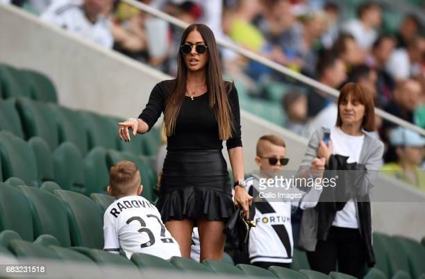 Sandra Radovic wife of Miroslav Radovic of Legia Warszawa with kids during in the match of the league Extraklasa between Legia Warszawa and Termalica...