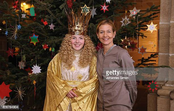 Sandra Reichel tennis tournament director of Nuernberger Versicherungscup poses with actress Barbara Otto dressed as 'Nuremberg Christkind' at...