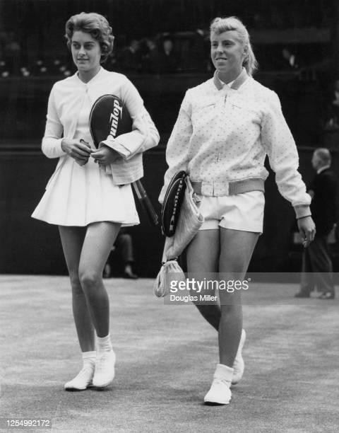 Sandra Reynolds of South Africa and Ann HaydonJones of Great Britain walk onto centre court before their Women's Singles SemiFinal match at the...