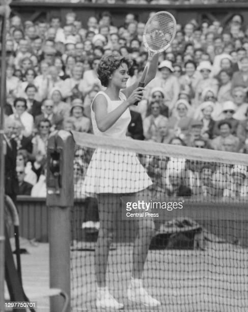 Sandra Reynolds of South Africa raises her arms and tennis racquet to celebrate winning her Women's Singles Semi Final match on Centre Court against...