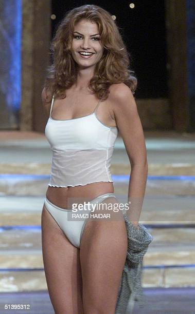 Sandra Rizk poses in a swim suit before being elected Miss Lebanon 2000 at the Casino du Liban in the Mediterranean port of Jounieh north of Beirut...