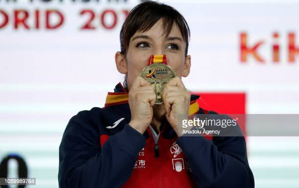 Sandra Sanchez of Spain kisses her gold medal after winning her Women's Individual Kata gold medal match against Kiyou Shimizu of Japan within the...