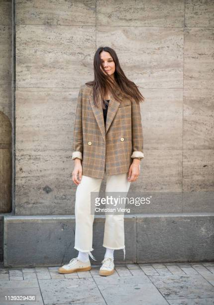 Sandra Sandor is seen wearing brown plaid blazer outside Nanushka brunch during the Budapest Central European Fashion Week on March 30 2019 in...
