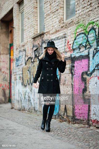 Sandra Schild wearing Zara poses for photos during the MercedesBenz Fashion Week Berlin A/W 2017 at Kaufhaus Jandorf on January 19 2017 in Berlin...