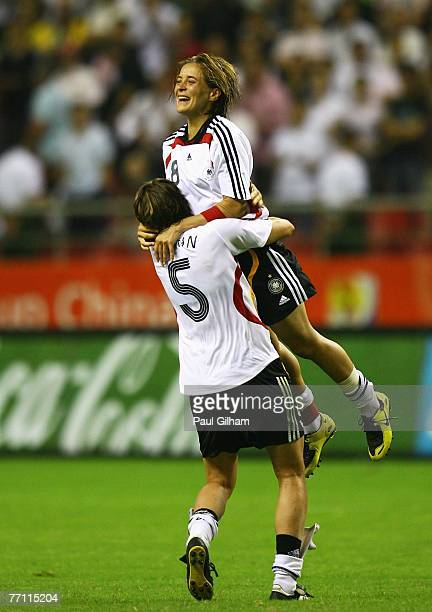 Sandra Smisek and Annike Krahn of Germany celebrate victory at the final whistle in the Women's World Cup 2007 Final between Brazil and Germany at...