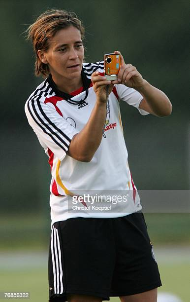 Sandra Smisek makes pictures during the Women's German National Team training session on the training ground at the Wuhan Sports Center Stadium on...