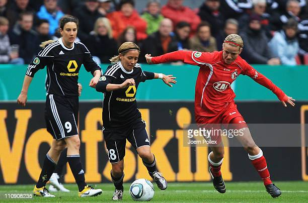 Sandra Smisek of Frankfurt and Viola Odebrecht of Potsdam battle for the ball during the DFB Women's Cup final match between 1 FFC Frankfurt and...