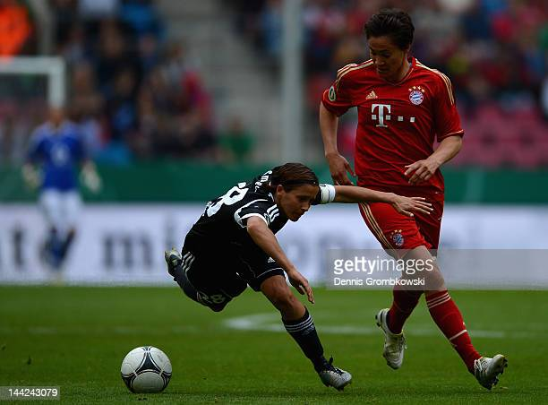 Sandra Smisek of Frankfurt challenged by Nicole Cross of Muenchen during the Women's DFB Cup Final between 1 FFC Frankfurt and Bayer Muenchen at...