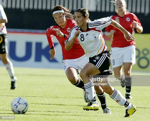 Sandra Smisek of Germany and Ingvild Stensland of Norway run for the ball during the Women's international friendly match between Norway and Germany...