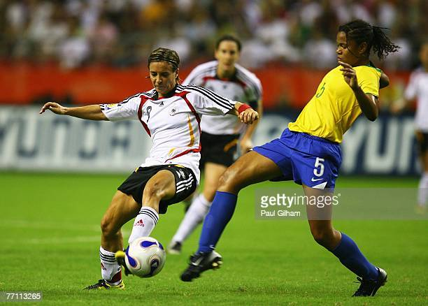 Sandra Smisek of Germany battles for the ball with Renata Costa Da Costa of Brazil during the Women's World Cup 2007 Final between Brazil and Germany...
