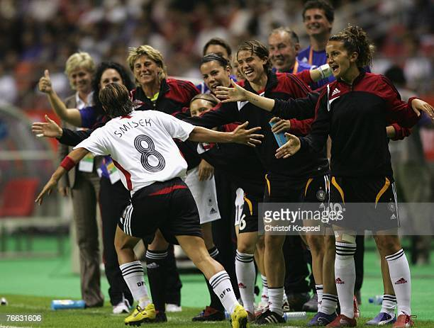 Sandra Smisek of Germany celebrates a goal with the substitute players during the FIFA Women's World Cup 2007 Group A match between Germany and...
