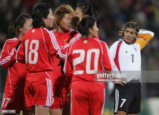 Sandra Smisek of Germany looks dejected while China celebrates its 10 goal win during the women's international friendly match between Germany and...