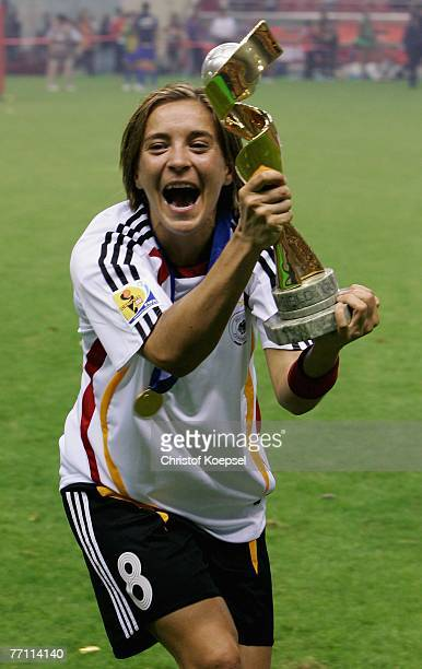 Sandra Smisek of Germany presents the winning trophee after the Women's World Cup 2007 Final match between Brazil and Germany at the Shanghai Hongkou...