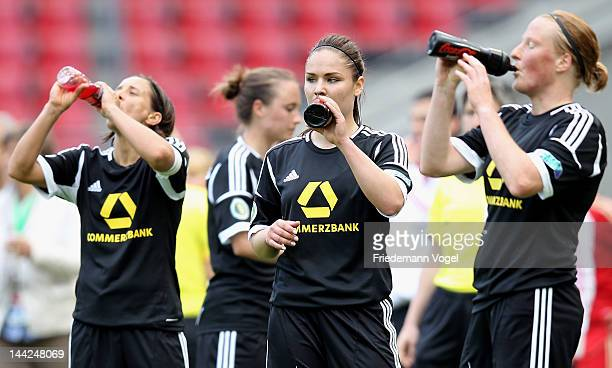 Sandra Smisek Silvana Chojnowski and Melanie Behringer of Frankfurt drink during the DFB Women's Cup final match between 1 FFC Frankfurt and Bayern...