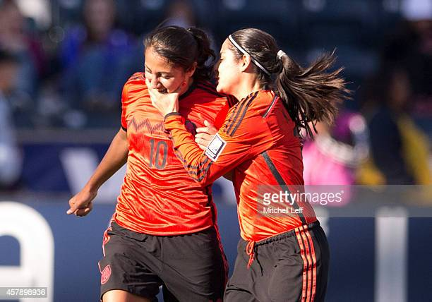 Sandra Stephany Mayor and Kenti Robles of Mexico react after Mayor scored a goal ini the first half against Trinidad Tobago to the 2014 CONCACAF...