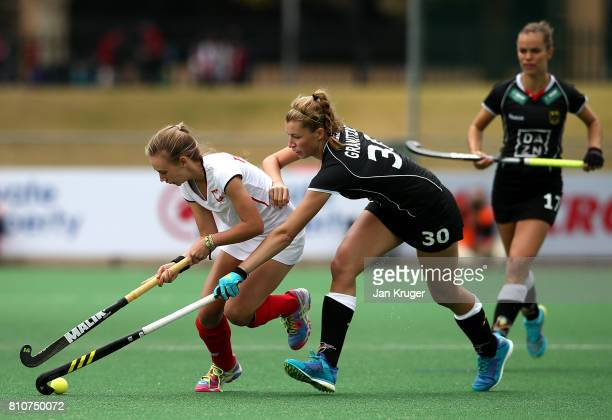 Sandra Tatarczuk of Poland battles with Hanna Granitzki of Germany during day 1 of the FIH Hockey World League Semi Finals Pool A match between...