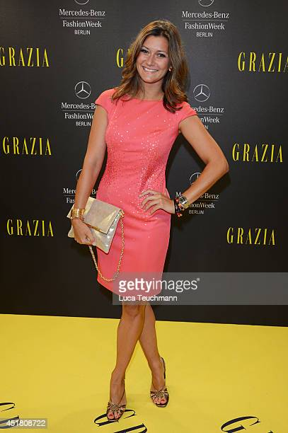 Sandra Thier arrives for the Opening Night by Grazia fashion show during the Mercedes-Benz Fashion Week Spring/Summer 2015 at Erika Hess Eisstadion...