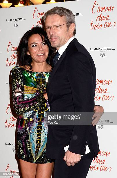 Sandra Zeitoun and Lambert Wilson attend 'L'Amour Dure Trois Ans' Premiere At the Grand Rex on January 7 2012 in Paris France