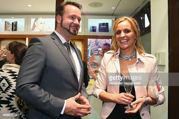 SandraMaria Gronewald attends with Sebastian Langer director of Kryolan the Kryolan MakeUp Shop Opening on May 8 2014 in Munich Germany