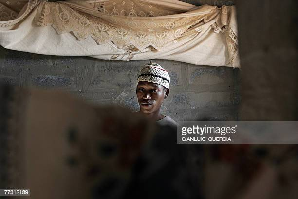 Sandri Matenda, an !xung member of the SAN community, stands in his house, 01 September 2007, in the Platfontein SAN settlement on the outskirt of...