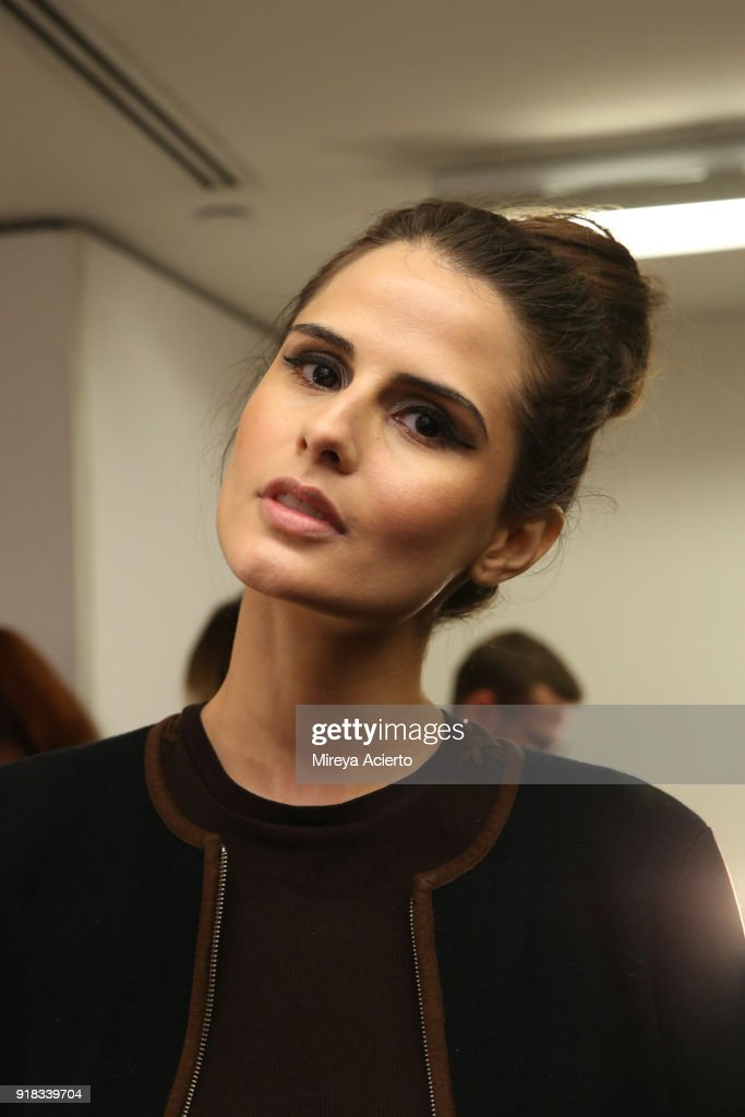 Sandrina Bencomo poses backstage for Irina Vitjaz during New York Fashion Week: The Shows at Gallery I at Spring Studios on February 14, 2018 in New York City.