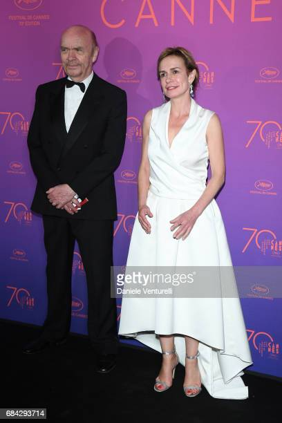 Sandrine Bonnaire and a guest attend the Opening Gala dinner during the 70th annual Cannes Film Festival at Palais des Festivals on May 17 2017 in...