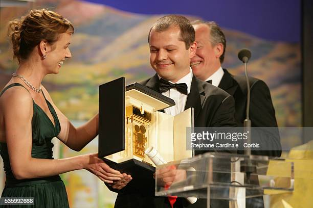 Sandrine Bonnaire presents the Camera d'Or award to Romanian director Corneliu Porumboiu at the closing ceremony of the 59th Cannes Film Festival