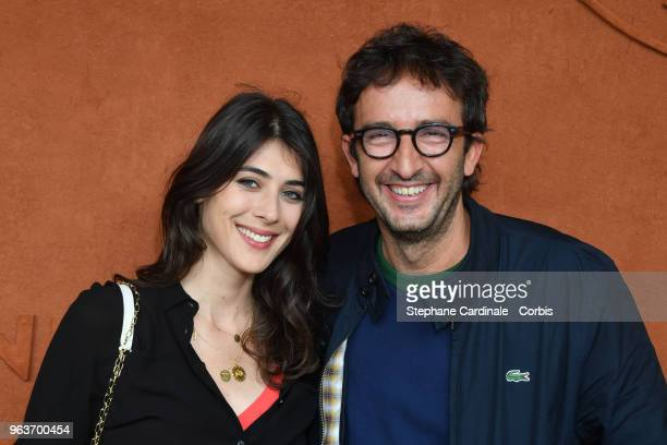 Sandrine Calvayrac and Cyrille Eldin attend the 2018 French Open Day Four at Roland Garros on May 30 2018 in Paris France
