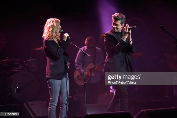 Sandrine Kiberlain and Benjamin Biolay perform during the Charity Gala against Alzheimer's disease at Salle Pleyel on February 12 2018 in Paris France