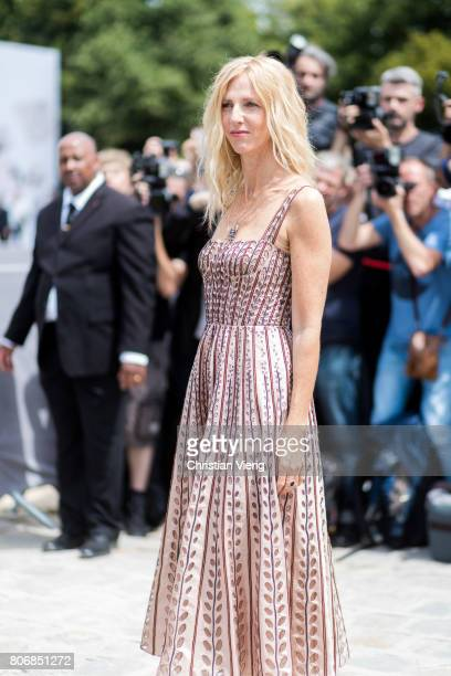 Sandrine Kiberlain outside Dior during Paris Fashion Week Haute Couture Fall/Winter 20172018 Day Two on July 3 2017 in Paris France