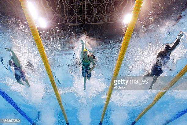 Sandrine Mainville of Canada Emma McKeon of Australia and Simone Manuel of the United States compete in the Final of the Women's 4 x 100m Freestyle...