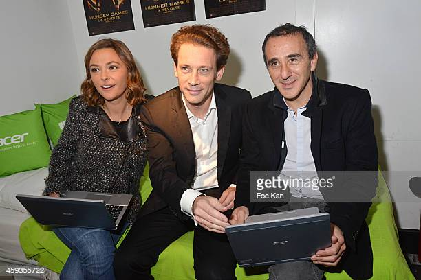 Sandrine Quetier Acer Marketing director Fabrice Massin and Elie Semoun attend the Acer Pop Up Store Launch Party at Les Halles on November 20 2014...
