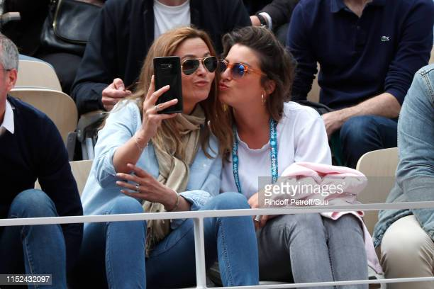Sandrine Quetier and a guest attend the 2019 French Tennis Open Day Four at Roland Garros on May 29 2019 in Paris France